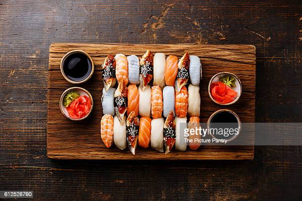 Nigiri sushi set for two on wooden serving board block