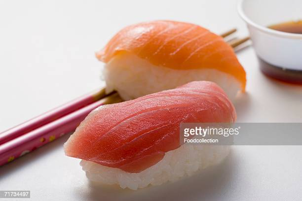 Nigiri sushi with tuna & salmon, chopsticks & soy sauce