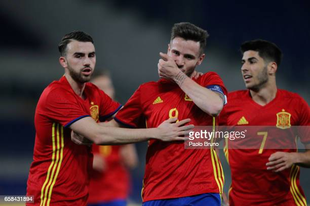 Niguez Saul with his teammate Asensio Marco and Mayoral Borja of Spain U21 celebrates after scoring the opening during the international friendly...