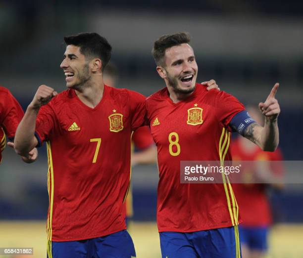 Niguez Saul with his teammate Asensio Marco of Spain U21 celebrates after scoring the opening during the international friendly match between Italy...