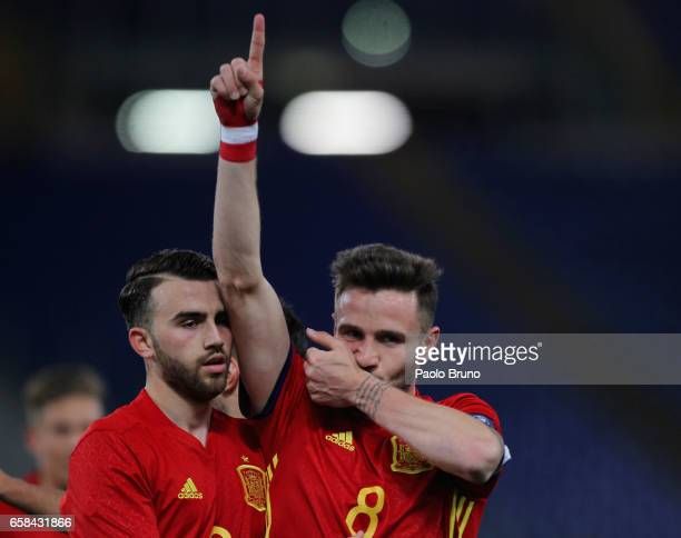 Niguez Saul with his teammate Mayoral Borja of Spain U21 celebrates after scoring the opening during the international friendly match between Italy...