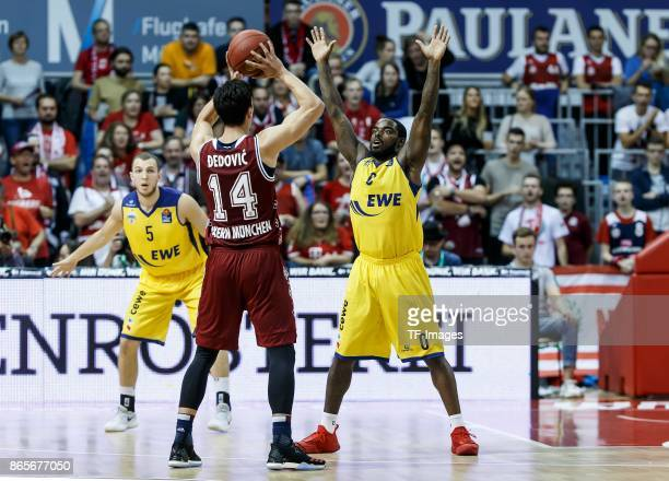 Nihad Djedovic of Bayern Muenchen and Bryon Allen of Oldenburg battle for the ball during the easyCredit BBL Basketball Bundesliga match between FC...