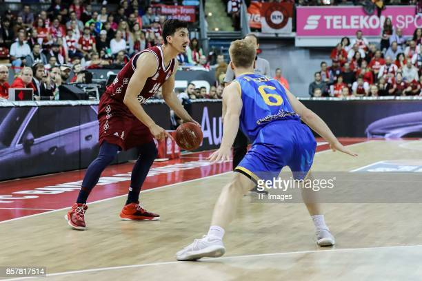 Nihad Djedovic of Bayern Muenchen and Luis Figge battle for the ball during the easyCredit BBL Basketball Bundesliga match between FC Bayern Muenchen...