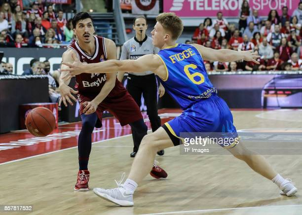 Nihad Djedovic of Bayern Muenchen and Luis Figge of Braunschweig battle for the ball during the easyCredit BBL Basketball Bundesliga match between FC...