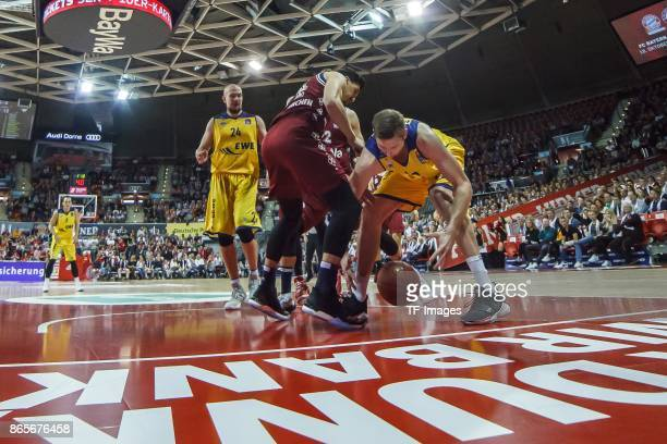 Nihad Djedovic of Bayern Muenchen and Maxime de Zeeuw of Oldenburg battle for the ball during the easyCredit BBL Basketball Bundesliga match between...