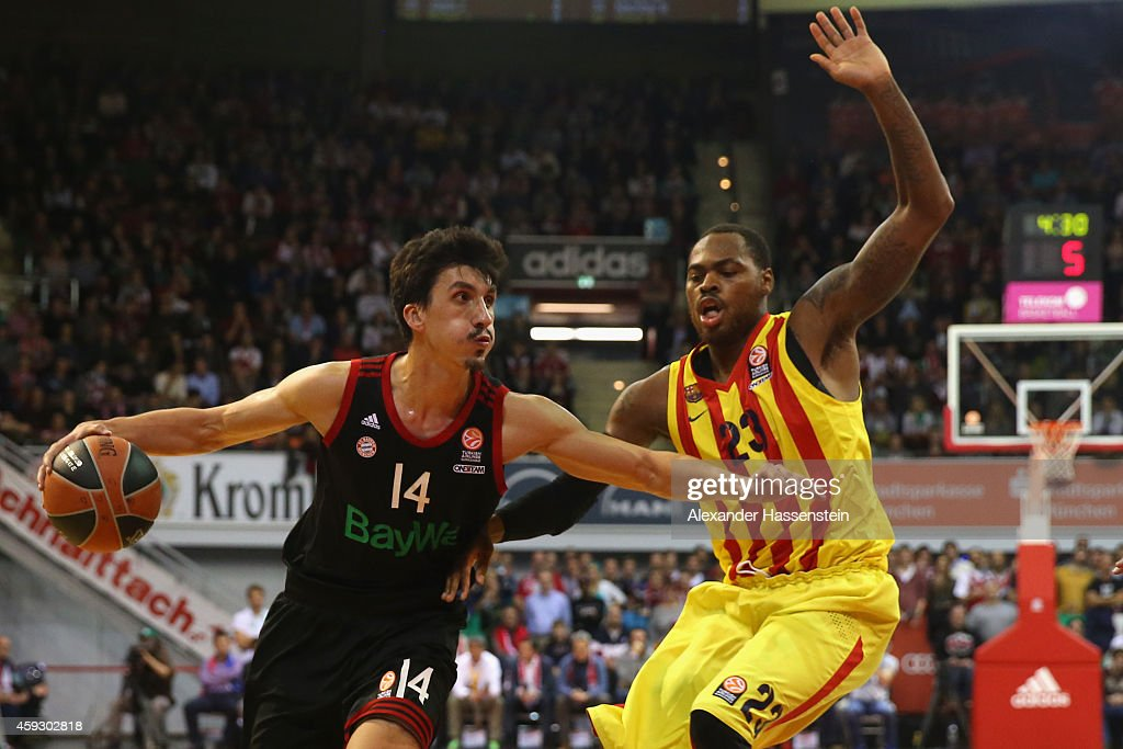 Nihad Djedovic of Bayern Muenchen in action with Deshaun Thomas of Barcelona during the Euroleague Basketball match between FC Bayern Munich and FC...