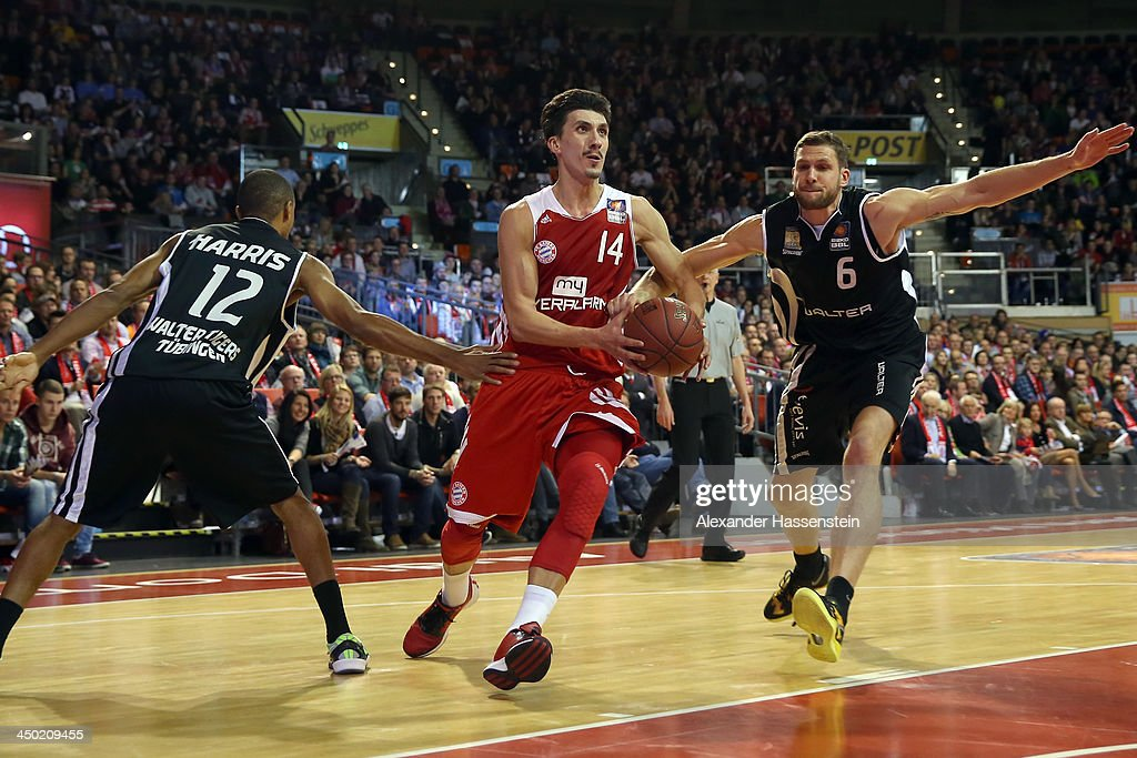 Nihad Djedovic (C) of Muenchen is challenged by Alex Harris (L) of Tuebingen and his team mate Nils Mittmann during the Beko Basketball Bundesliga match between FC Bayern Muenchen and WALTER Tigers Tuebingen at Audi-Dome on November 17, 2013 in Munich, Germany.
