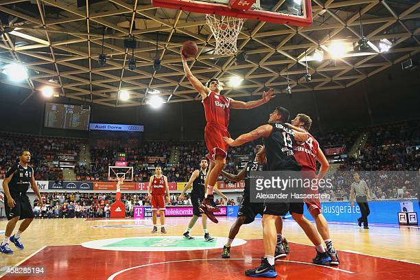 Nihad Djedovic of Muenchen scores a point during the Beko Basketball Bundesliga match between FC Bayern Muenchen and WALTER Tigers Tuebingen at...
