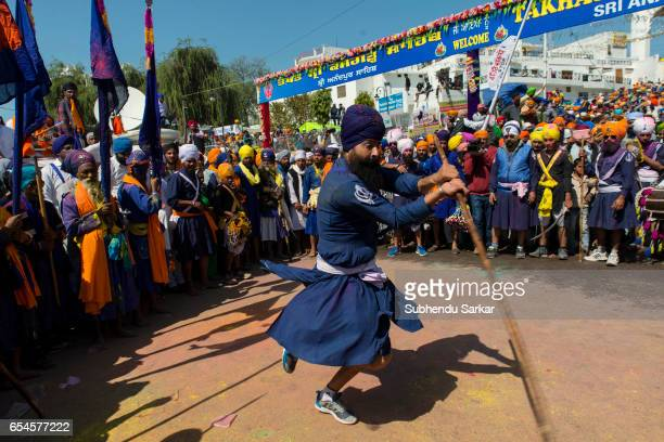 Nihang Sikh displays martial arts skill during Hola Mohalla festival Hola Mohalla is a threeday festival started by the tenth Sikh Guru Govind Singh...