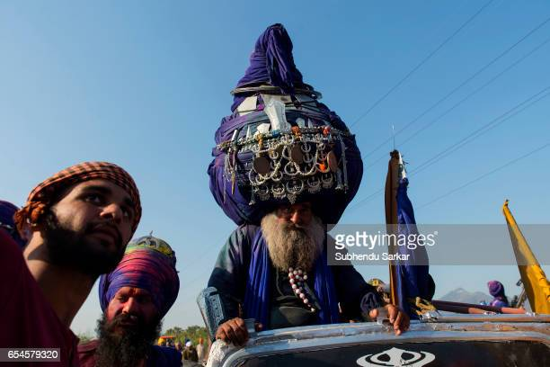 Nihang Sikh with a huge turban arrives at the ground where martial skills are displayed during Hola Mohalla festival Hola Mohalla is a threeday...