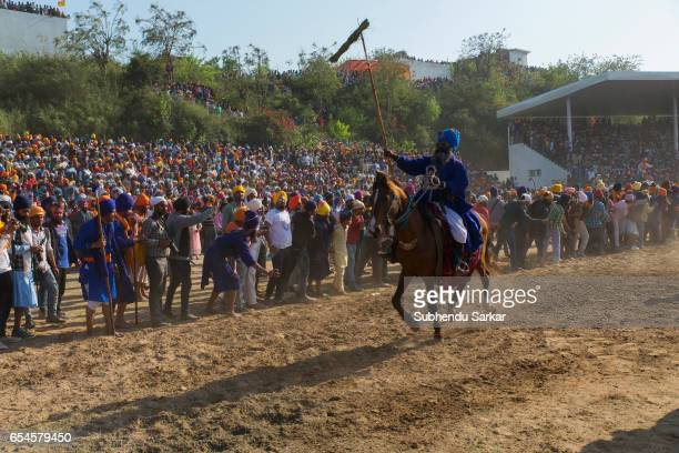 Nihang Sikhs display horse riding skills during Hola Mohalla festival Hola Mohalla is a threeday festival started by the tenth Sikh Guru Govind Singh...