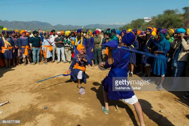 Nihang Sikhs display martial arts skill during Hola Mohalla festival Hola Mohalla is a threeday festival started by the tenth Sikh Guru Govind Singh...