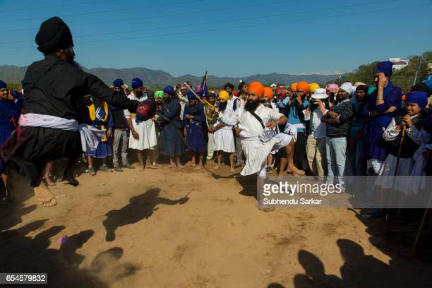 Nihang Sikhs display martial arts skills during Hola Mohalla festival Hola Mohalla is a threeday festival started by the tenth Sikh Guru Govind Singh...
