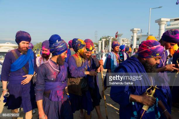 Nihang Sikhs leave the ground after the conclusion of Hola Mohalla festival Hola Mohalla is a threeday festival started by the tenth Sikh Guru Govind...