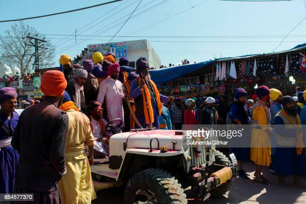 Nihang Sikhs move from their camps towards the ground to display martial arts skill during Hola Mohalla festival Hola Mohalla is a threeday festival...