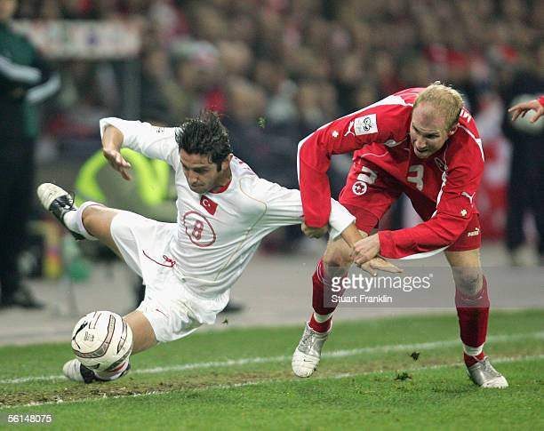 Nihat Kahveci of Turkey is challenged by Ludovic Magnin of Switzerland during the Fifa World Cup 2006 football qualifier playoff match between...