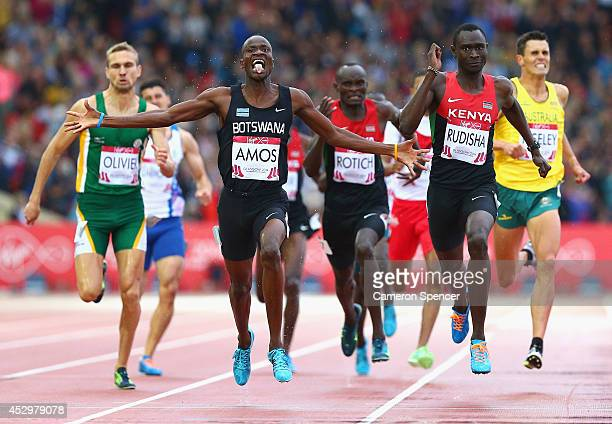 Nijel Amos of Botswana crosses the line to win gold ahead of David Rudisha of Kenya in the Men's 800 metres final at Hampden Park during day eight of...