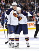 Nik Antropov and Maxim Afinogenov of the Atlanta Thrashers celebrate a thirdperiod goal against the Toronto Maple Leafs March 30 2010 at the Air...