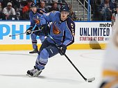 Nik Antropov of the Atlanta Thrashers carries the puck against the Boston Bruins at Philips Arena on March 23 2010 in Atlanta Georgia