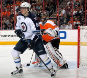 Nik Antropov of the Winnipeg Jets attempts to screen goaltender Ilya Bryzgalov of the Philadelphia Flyers on January 31 2012 at the Wells Fargo...