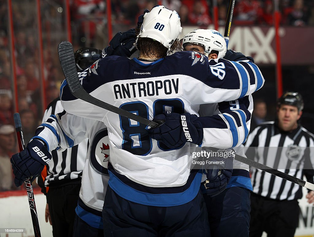 Nik Antropov #80 of the Winnipeg Jets celebrates with teammates after being credited with a goal against the Carolina Hurricanes to extend their lead to 3-1 in the second period during their NHL game at PNC Arena on March 26, 2013 in Raleigh, North Carolina.