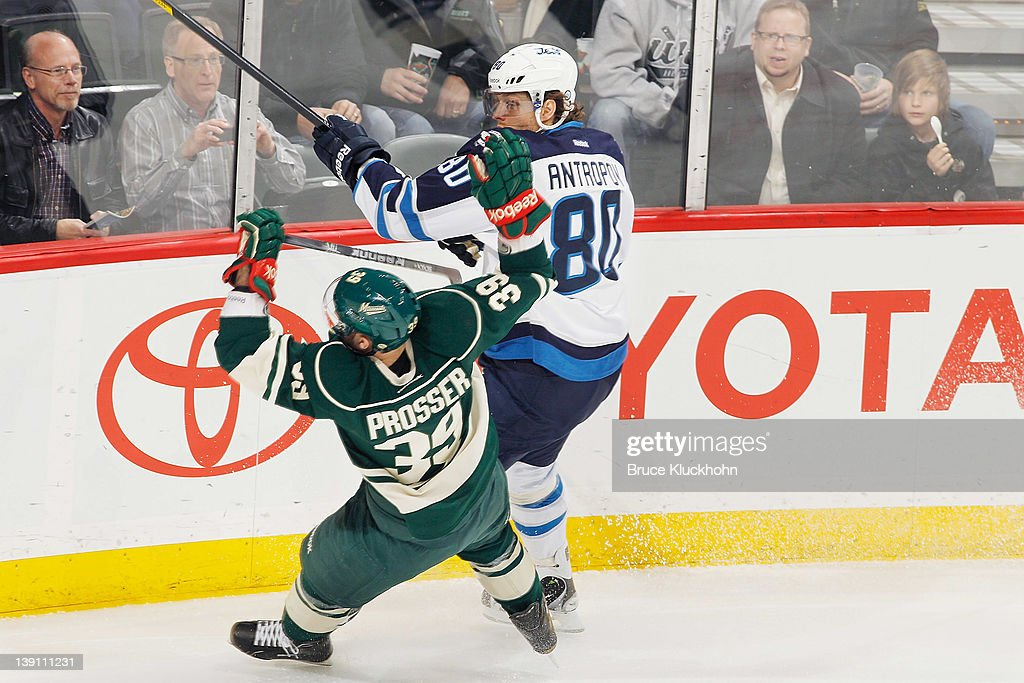 <a gi-track='captionPersonalityLinkClicked' href=/galleries/search?phrase=Nik+Antropov&family=editorial&specificpeople=202953 ng-click='$event.stopPropagation()'>Nik Antropov</a> #80 of the Winnipeg Jets checks Nate Prosser #39 of the Minnesota Wild during the game at the Xcel Energy Center on February 16, 2012 in St. Paul, Minnesota.