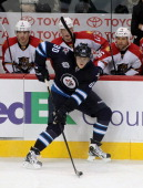 Nik Antropov of the Winnipeg Jets controls the puck along the boards during a game against the Florida Panthers in NHL action at the MTS Centre on...