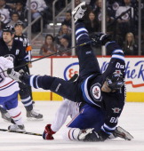 Nik Antropov of the Winnipeg Jets flies over the top of Brendan Gallagher of the Montreal Canadiens during second period NHL action on April 25 2013...