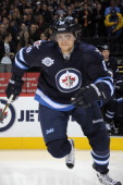 Nik Antropov of the Winnipeg Jets hits the ice prior to facing the Pittsburgh Penguins at the MTS Centre on December 23 2011 in Winnipeg Manitoba...