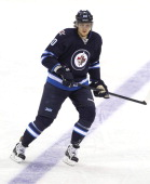 Nik Antropov of the Winnipeg Jets keeps his eye on the play as he skates down the ice during a game against the New York Islanders on January 27 2013...