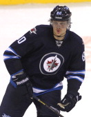 Nik Antropov of the Winnipeg Jets keeps his eye on the play as he skates up the ice during a game against the Ottawa Senators on January 19 2013 at...