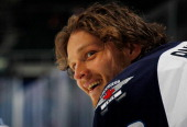 Nik Antropov of the Winnipeg Jets looks on during warmups prior to the game against the New York Islanders at Nassau Veterans Memorial Coliseum on...