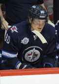 Nik Antropov of the Winnipeg Jets looks on from the bench during their NHL game against the Colorado Avalanche at MTS Centre on February 19 2012 in...