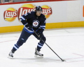 Nik Antropov of the Winnipeg Jets plays the puck during second period action against the Tampa Bay Lightning at the MTS Centre on March 24 2013 in...