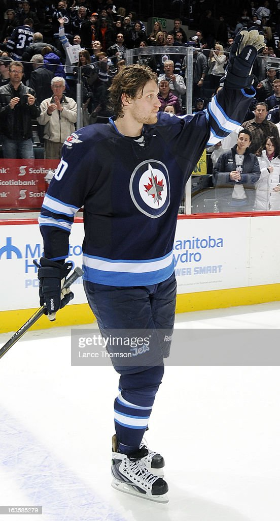 <a gi-track='captionPersonalityLinkClicked' href=/galleries/search?phrase=Nik+Antropov&family=editorial&specificpeople=202953 ng-click='$event.stopPropagation()'>Nik Antropov</a> #80 of the Winnipeg Jets salutes the fans after being named first star of the game following a 5-2 win over the Toronto Maple Leafs at the MTS Centre on March 12, 2013 in Winnipeg, Manitoba, Canada.