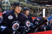 Nik Antropov of the Winnipeg Jets sits on the bench prior to facing the New York Islanders at the MTS Centre on February 14 2012 in Winnipeg Manitoba...