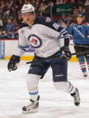 Nik Antropov of the Winnipeg Jets skates against the Colorado Avalanche at the Pepsi Center on December 27 2011 in Denver Colorado The Jets defeated...