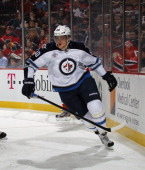 Nik Antropov of the Winnipeg Jets skates against the New Jersey Devils at the Prudential Center on January 17 2012 in Newark New Jersey The Devils...