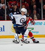 Nik Antropov of the Winnipeg Jets skates against the New Jersey Devils at the Prudential Center on March 10 2013 in Newark New Jersey The Devils...