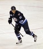 Nik Antropov of the Winnipeg Jets skates against the Ottawa Senators at the MTS Centre on November 29 2011 in Winnipeg Canada The Senators defeated...