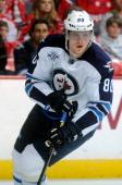Nik Antropov of the Winnipeg Jets skates down the ice against the Washington Capitals at the Verizon Center on November 23 2011 in Washington DC The...