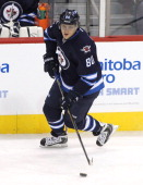 Nik Antropov of the Winnipeg Jets skates down the ice during first period action in a matchup between the Winnipeg Jets and the Boston Bruins on...