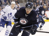 Nik Antropov of the Winnipeg Jets skates down the ice during second period action in a game against the Toronto Maple Leafs on March 12 2013 at the...