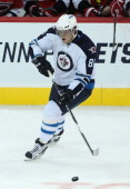 Nik Antropov of the Winnipeg Jets skates on the ice in a game against the Carolina Hurricanes in preseason NHL action at the MTS Centre on September...