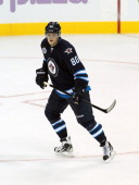 Nik Antropov of the Winnipeg Jets skates on the ice in a game against the Carolina Hurricanes in NHL action at the MTS Centre on October 22 2011 in...