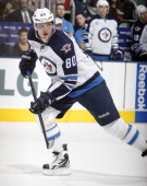 Nik Antropov of the Winnipeg Jets skates up the ice during NHL action against the Toronto Maple Leafs at the Air Canada Centre October 19 2011 in...