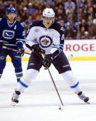 Nik Antropov of the Winnipeg Jets skates with the puck during NHL action against the Vancouver Canucks on March 08 2012 at Rogers Arena in Vancouver...