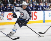 Nik Antropov of the Winnipeg Jets skates with the puck in a game against the Toronto Maple Leafs on March 16 2013 at the Air Canada Centre in Toronto...