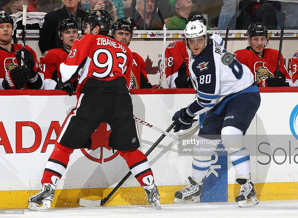 Nik Antropov #80 of the Winnipeg Jets watches the puck after making a pass as Mika Zibanejad #93 of the Ottawa Senators looks on, during an NHL game at Scotiabank Place, on March 17, 2013 in Ottawa, Ontario, Canada.