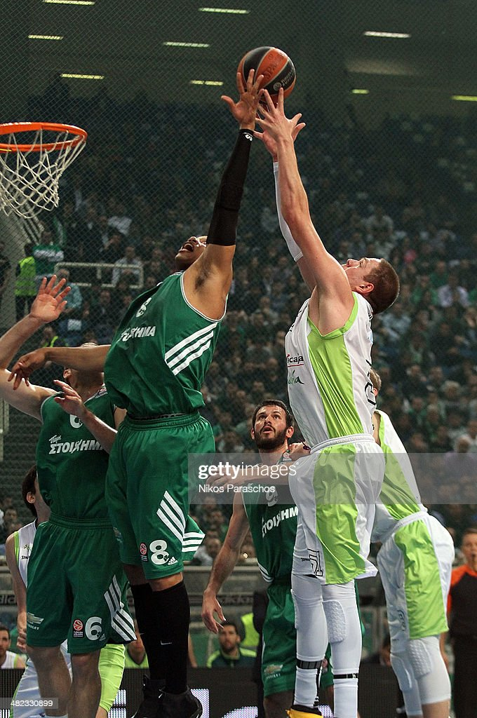 Nik CanerMedley #33 of Unicaja Malaga competes with Mike Batiste #8 of Panathinaikos Athens during the 20132014 Turkish Airlines Euroleague Top 16...